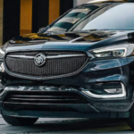 2021 Buick Enclave parked in front of a building