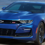 2021 Chevrolet Camaro driving down a highway road