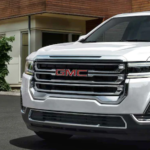 2022 GMC Acadia parked in front of a building