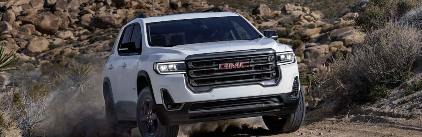 White 2022 GMC Acadia Front Exterior on a Trail