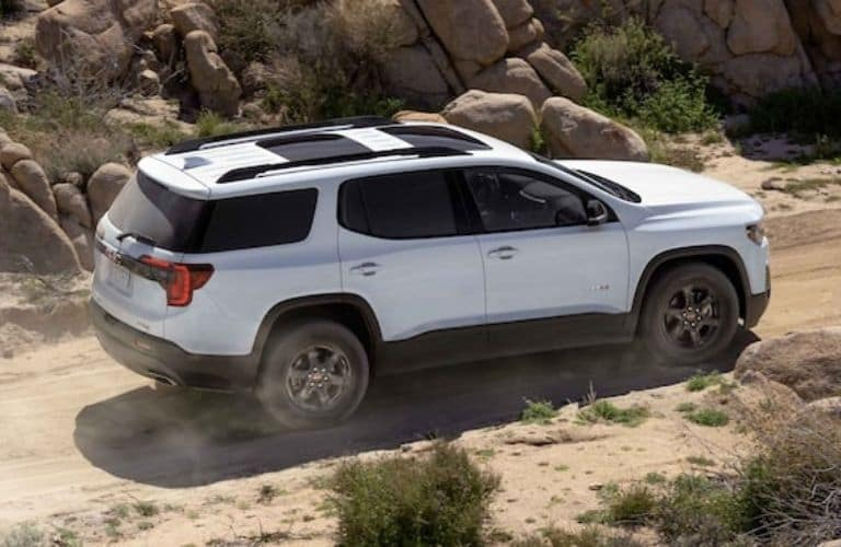 White 2022 GMC Acadia Rear Exterior on a Dirt Road