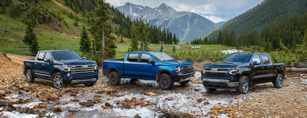 2022 Chevy Silverado Models in a valley in blue and black