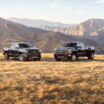 The Silverado and Colordo Chevy Trucks in a Field