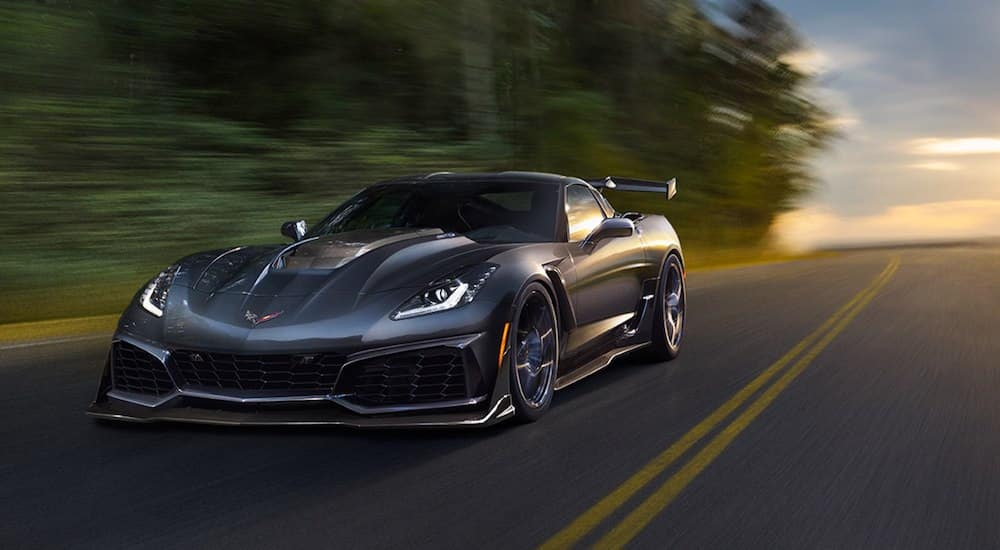 Gray 2019 Chevy Corvette driving on road at dusk
