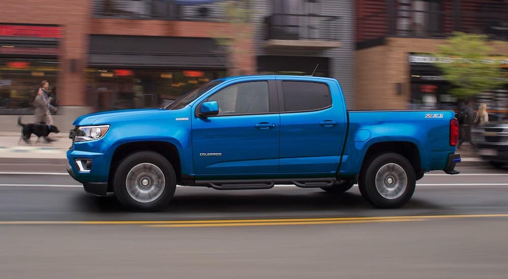 Blue 2019 Chevy Colorado on city street