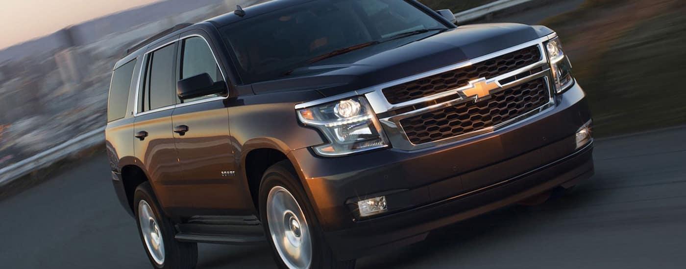Black 2019 Chevy Tahoe Driving