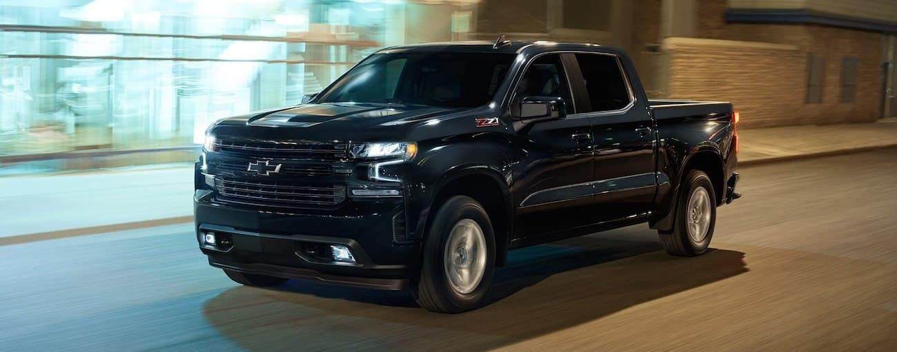 Black 2019 Chevy Silverado z71 driving at night