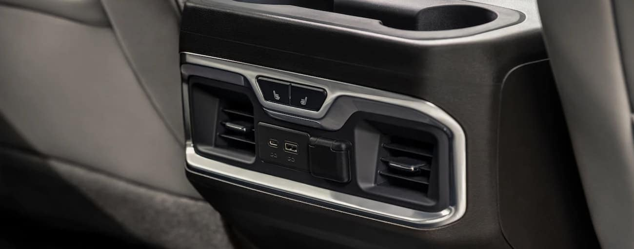 Temperature controls and ports in back seat of 2019 GMC Sierra 1500