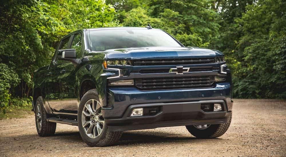 A deep blue 2019 Chevy Silverado on a small dirt road outside Nashville