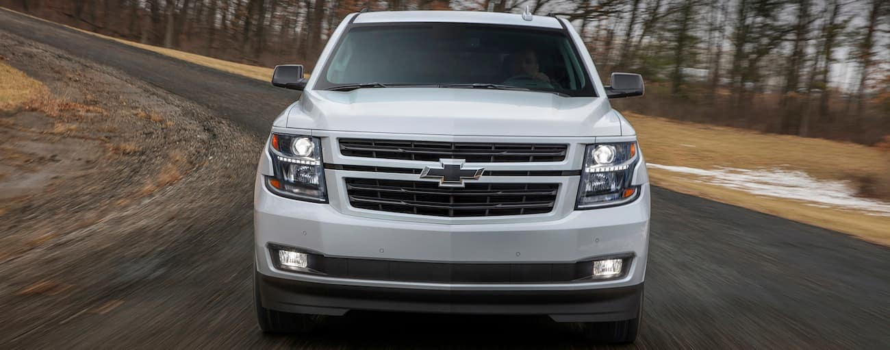 A white 2019 Chevy Tahoe RST races around a track