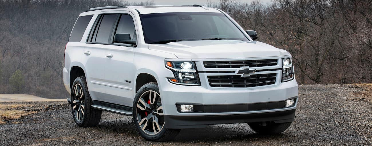 A white 2019 Chevy Tahoe RST in the woods