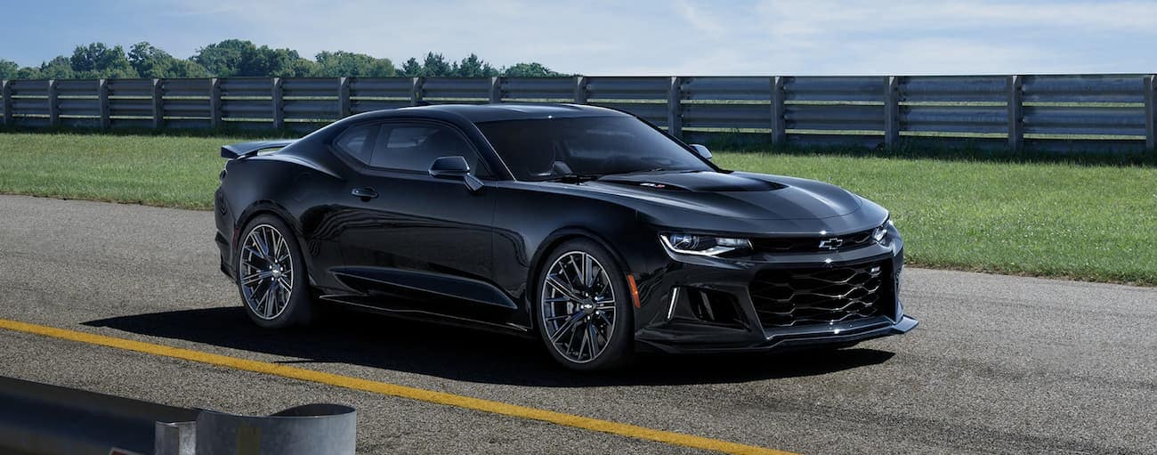 A black 2019 Chevy Camaro on a race track