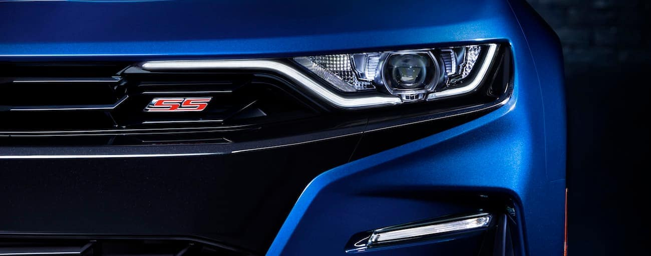 A closeup of a blue 2019 Chevy Camaro SS grille