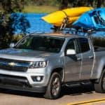 New Chevy Trucks including this silver 2019 Chevy Colorado with Kayaks on top