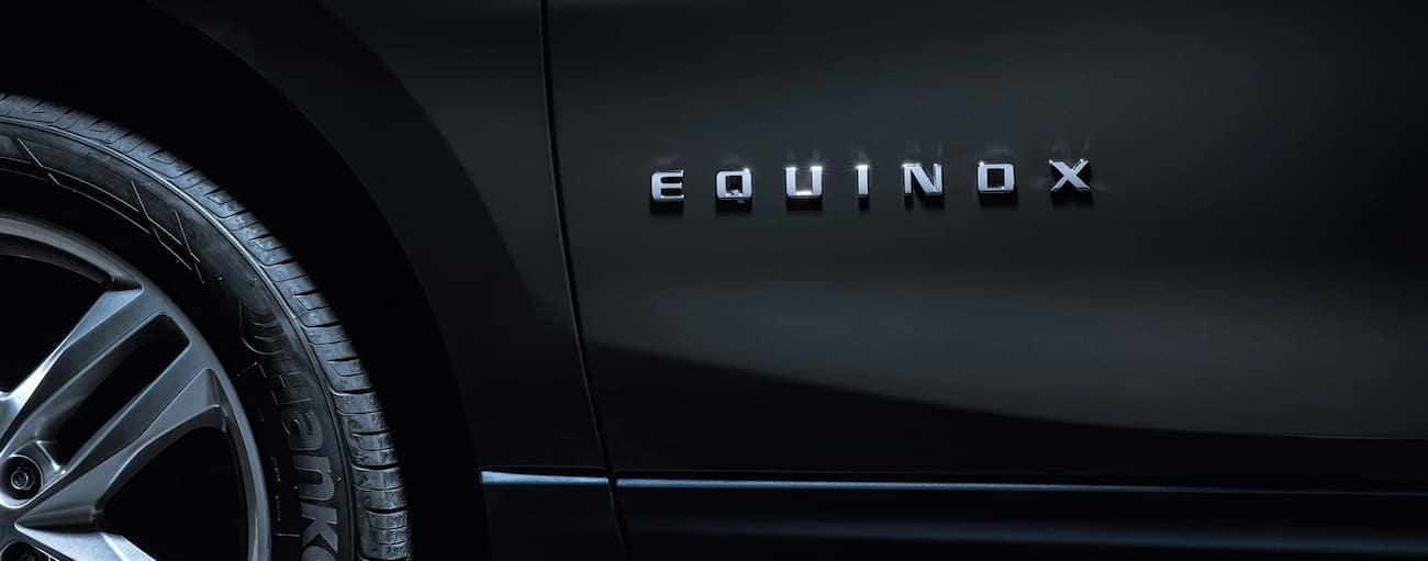 A closeup of the side badging on a black 2019 Chevy Equinox