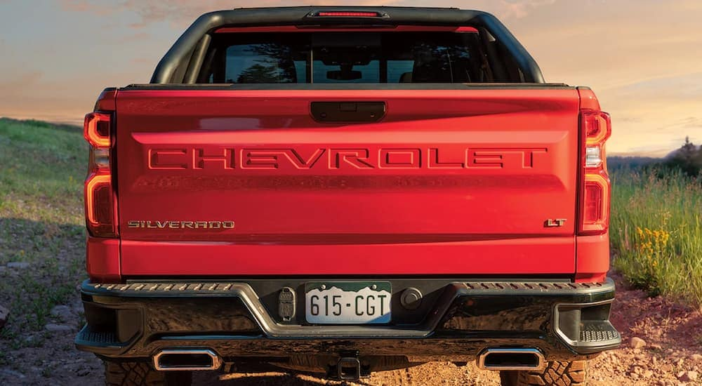 New Chevy trucks including this red 2019 Chevy Silverado LT at sunset