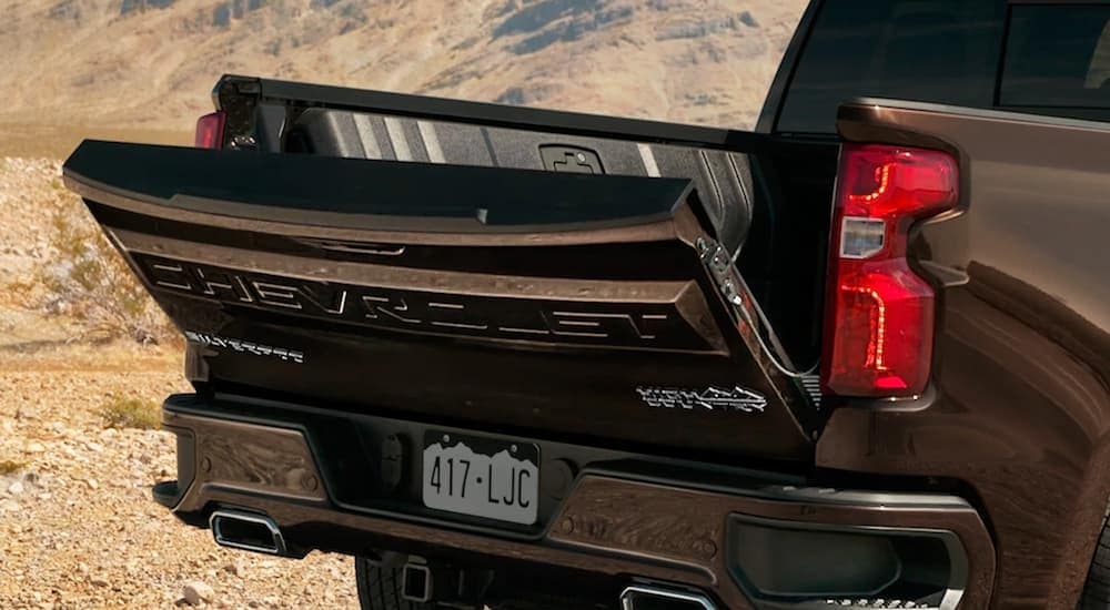 New Chevy Trucks including this black 2019 Chevy Silverado with the tailgate slightly ajar