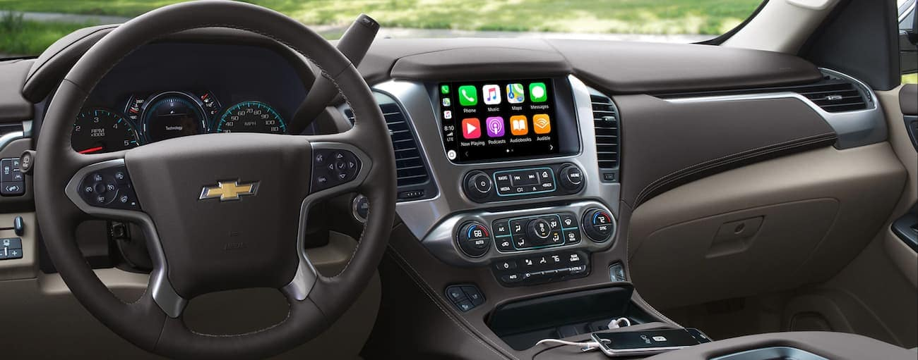 The interior and dashboard of a 2019 Chevy Tahoe
