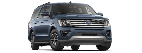 A blue 2019 Ford Expedition facing right on white