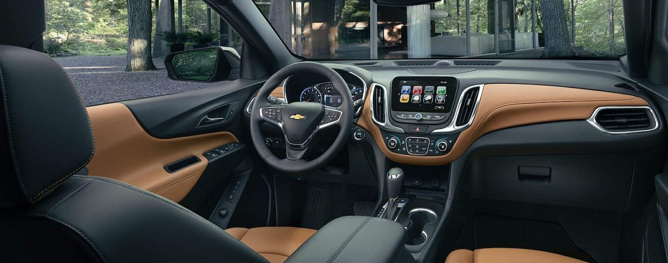 The high tech black and tan interior of the 2019 Chevy Equinox
