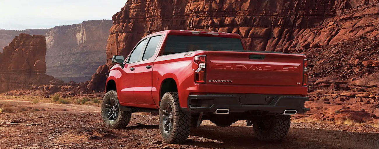 A red 2019 Chevy Silverado on a rocky of road trail