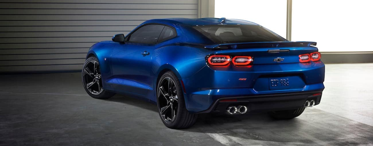 A dark blue 2019 Chevy Camaro SS in a garage