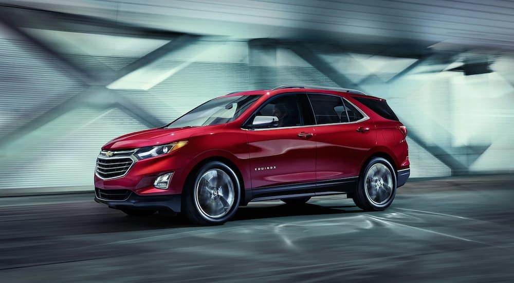 A red 2019 Chevy Equinox driving in a tunnel