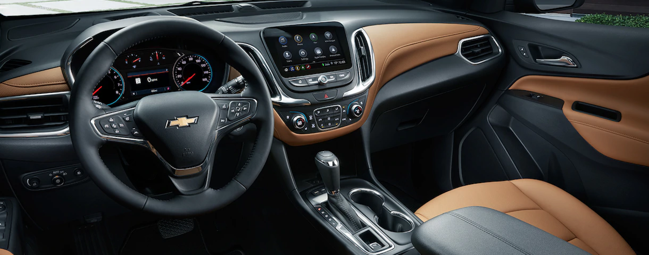 A the high tech black and tan leather interior of the 2019 Chevy Equinox