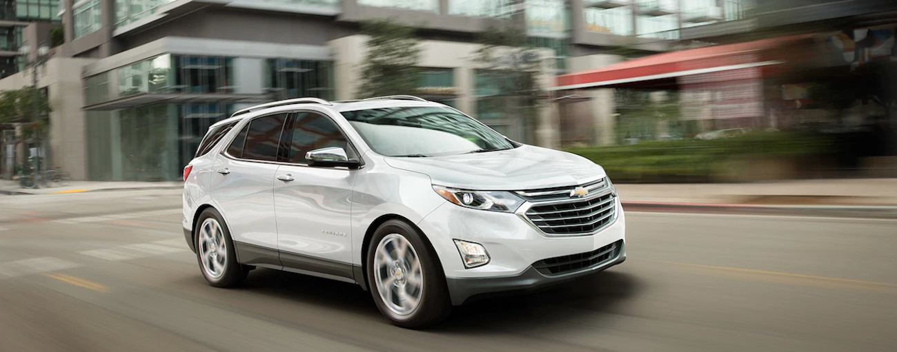 A white 2019 Chevy Equinox races down a Nashville street on a test drive from a local dealer