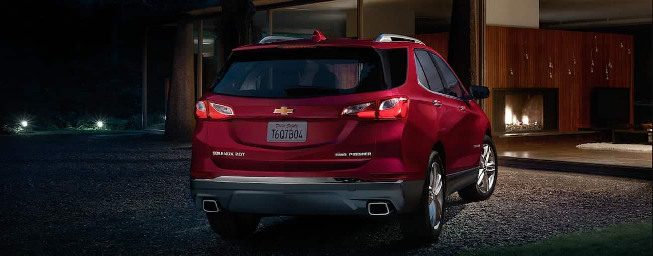 A deep red 2019 Chevy Equinox parked on a dark street