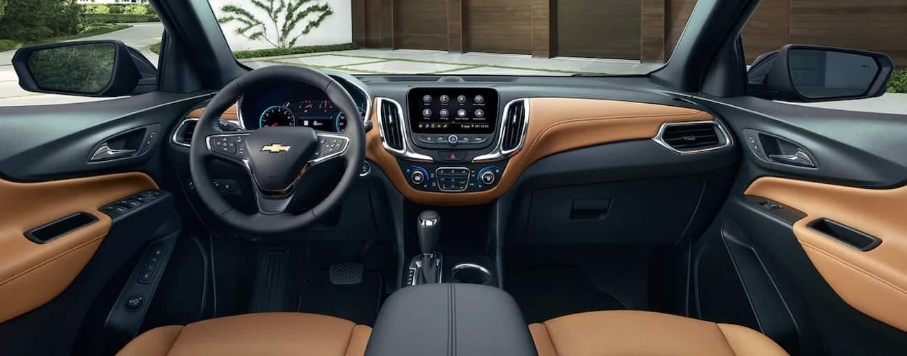 The high tech black and tan leather interior of the 2019 Chevy Equinox