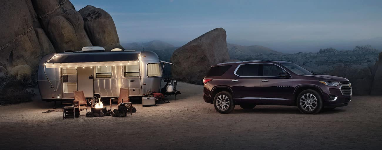 A maroon Traverse camps with an airstream after winning 2019 Chevy Traverse vs 2019 Honda Pilot