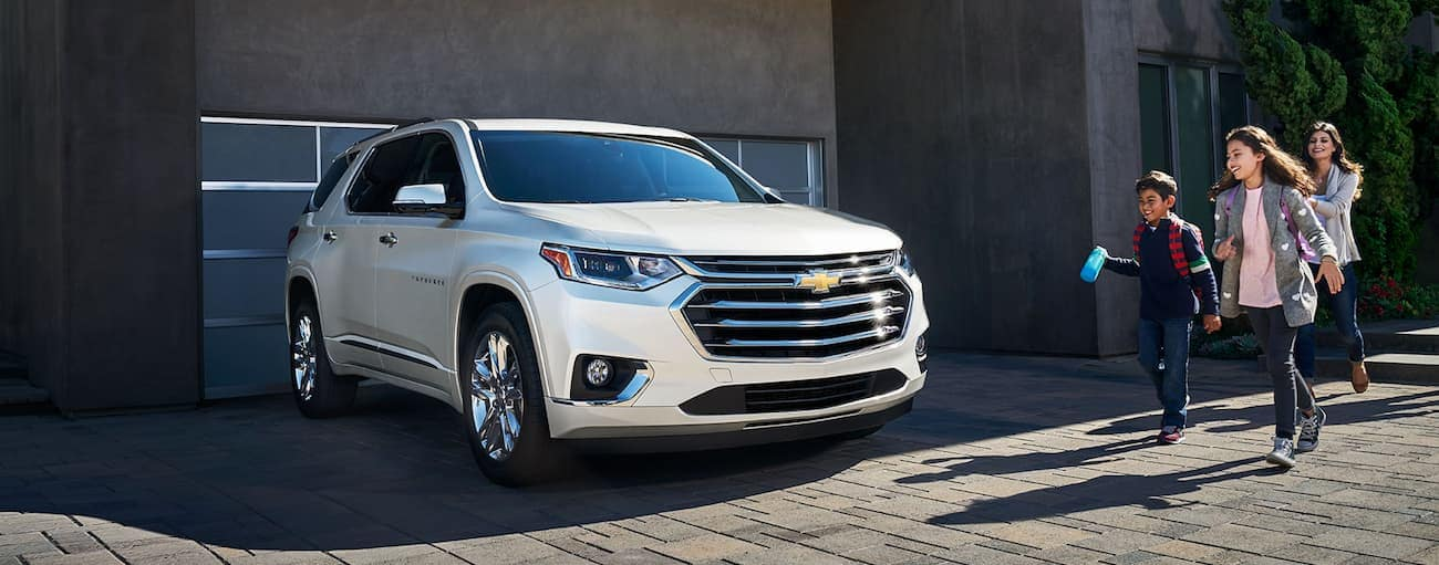 A family about to take their Traverse for a trip after winning 2019 Chevy Traverse vs 2019 Honda Pilot