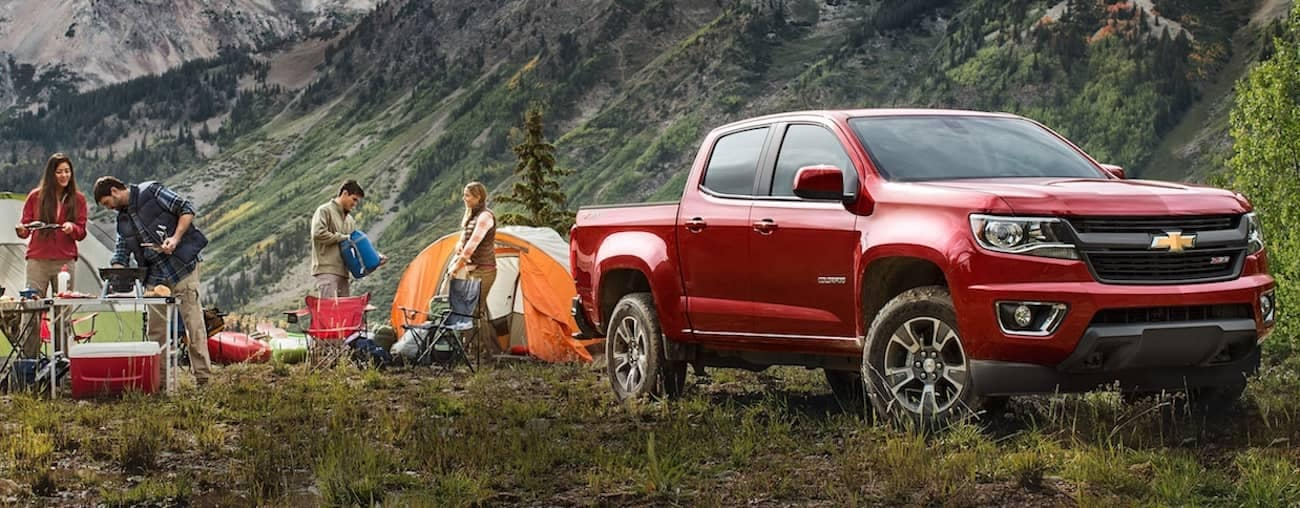 A red 2019 Chevy Colorado on a family camping trip outside Nashville
