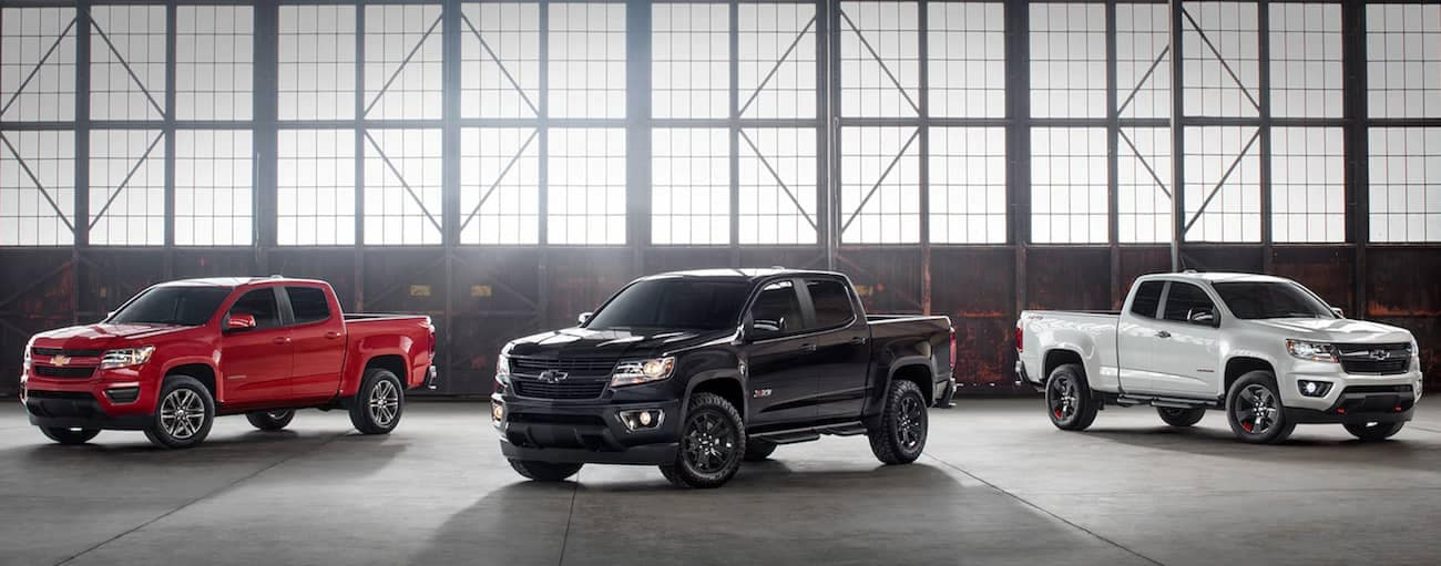 A few of the 2019 Chevy Colorado models in a large warehouse