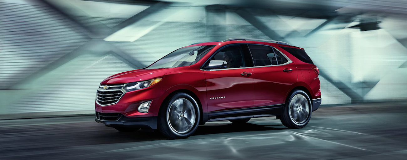 A red 2019 Chevy Equinox travels a city tunnel on a test drive