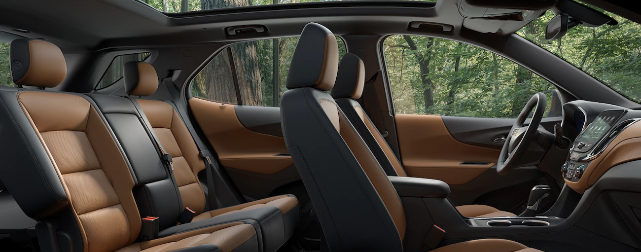 The high tech brown and black leather interior of the 2019 Chevy Equinox