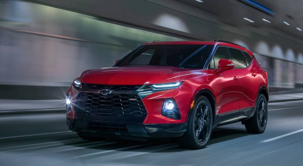 A red 2019 Chevy Blazer RS is driving in a tunnel. Check one out at one of the Tennessee Chevy Dealers.