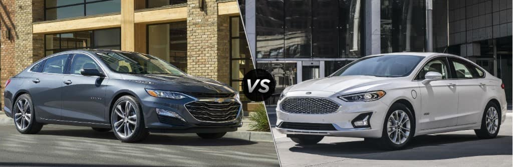 blue 2019 Chevy Malibu set against white 2019 Ford Fusion