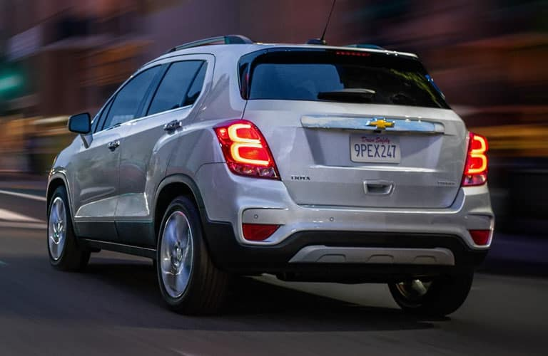 rear-side of silver 2019 Chevy Trax driving at dusk