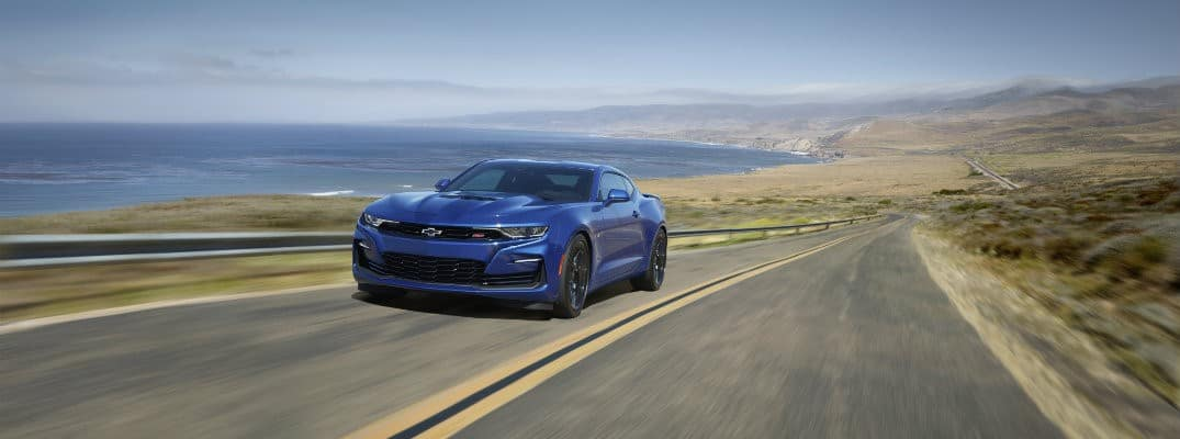 blue 2020 Chevy Camaro driving on coastal highway