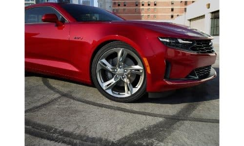 front end wheel view of red 2020 Chevy Camaro