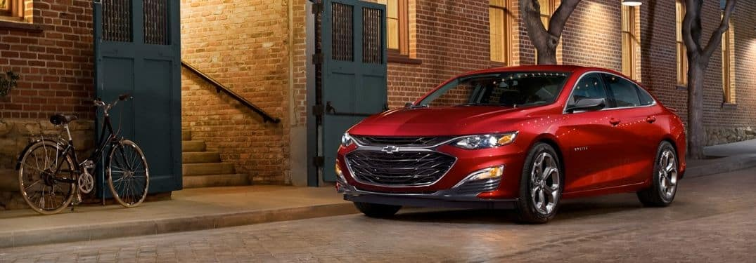 red 2019 Chevy Malibu parked on the street at dusk