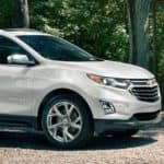 white 2019 Chevy Equinox parked in wooded area