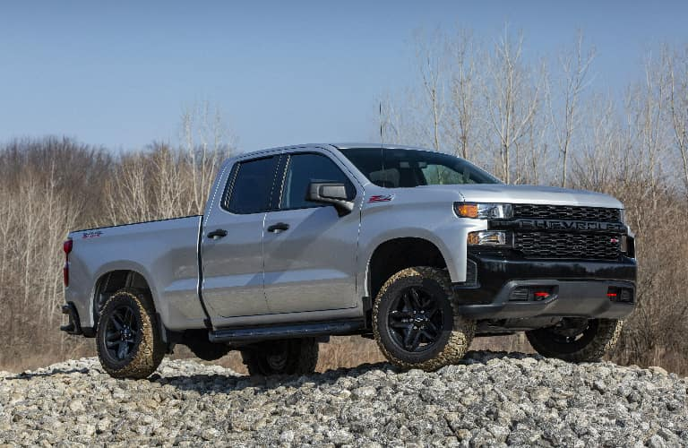 Silver 2020 Chevrolet Silverado 1500 parked on a pile of rocks