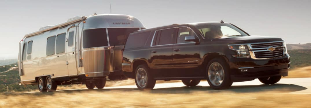 Black 2019 Chevrolet Suburban towing an Airstream trailer