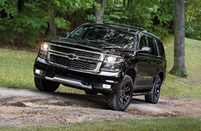 Black 2020 Chevrolet Tahoe driving up a hill
