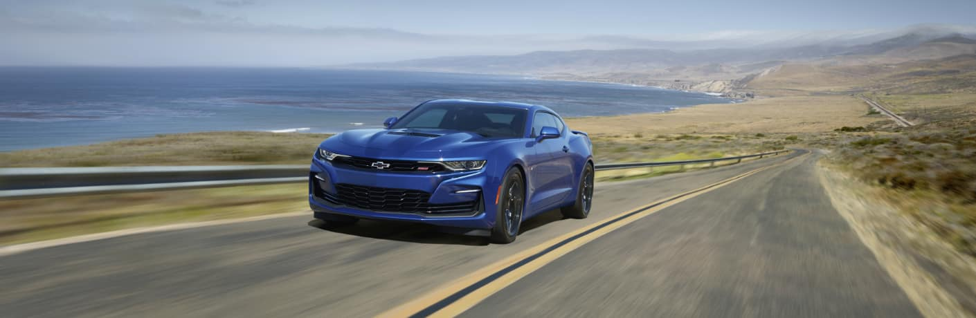 Blue 2020 Chevrolet Camaro driving on a coastal road