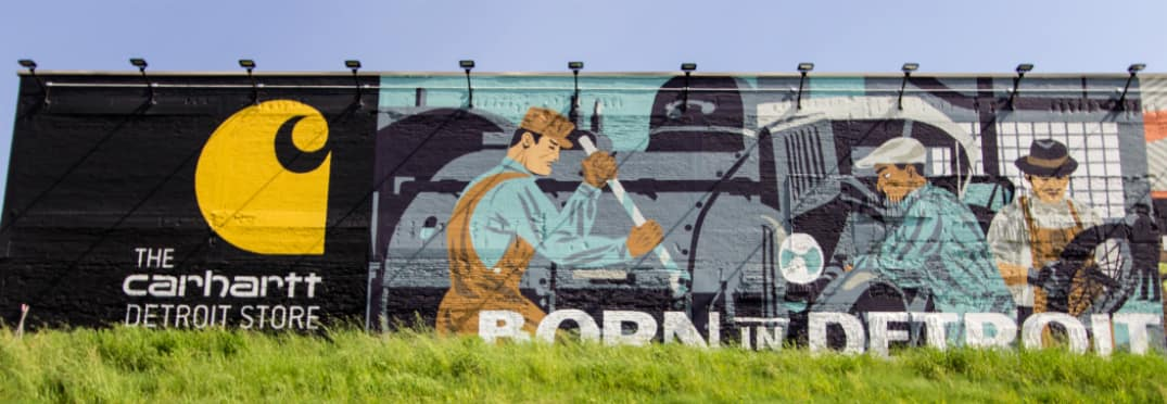 Carhartt billboard with an image of workers at automotive manufacturing plant