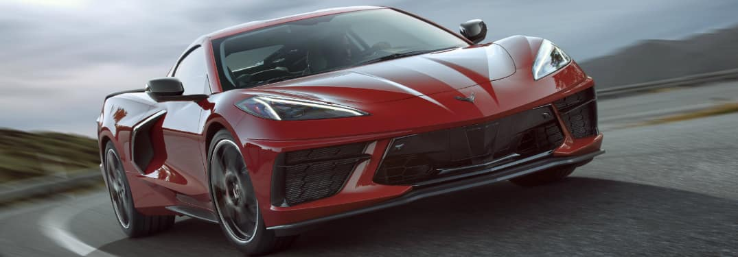 Red 2020 Chevrolet Corvette Stingray driving on a curvy road